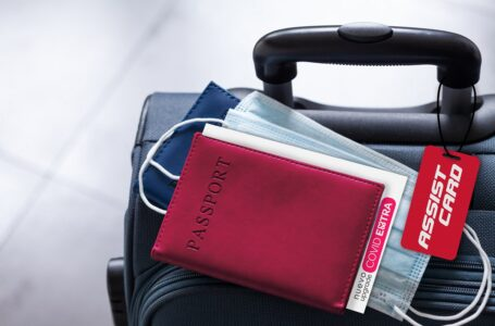 Travel suitcase, passport and medical mask. The ban on travel during the epidemic of the coronavirus and the introduction of quarantine concept.